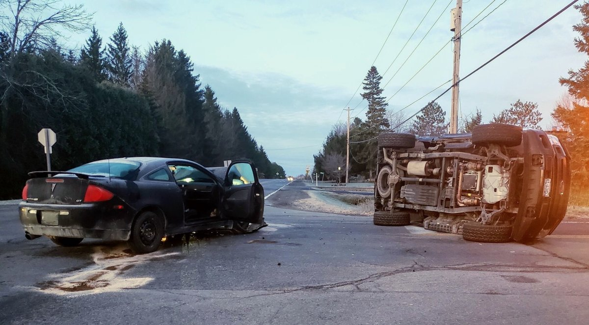 Ottawa police say one driver has been charged with disobeying a stop sign after a two-vehicle collision left a pickup truck flipped over in an intersection in Ottawa's south end on Monday morning.