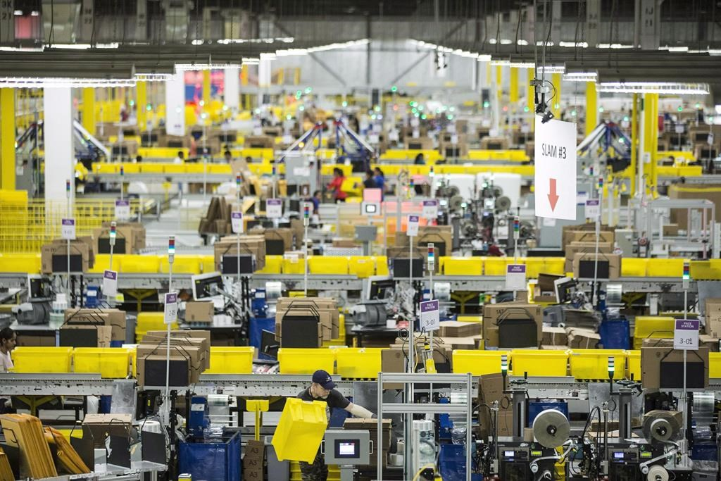 Employees work at the Amazon fulfillment centre in Brampton, Ont. on November 26, 2018. Amazon says it plans to open open five facilities in Quebec. Tuesday, Jan. 19, 2021.