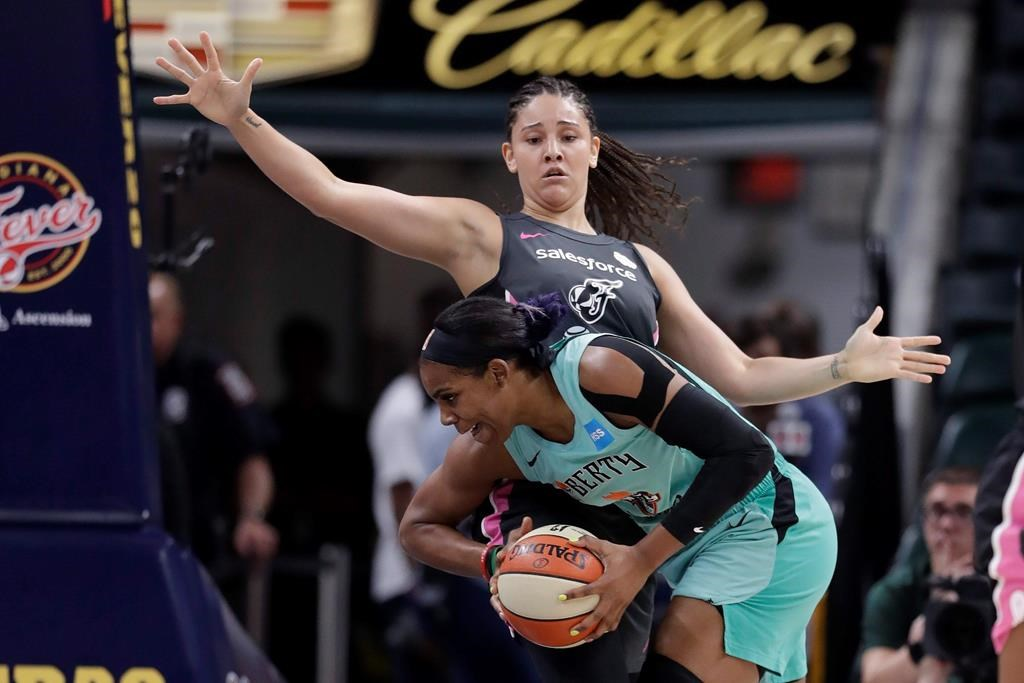 New York Liberty's Tina Charles (31) goes to the basket against Indiana Fever's Natalie Achonwa (11) during the first half of a WNBA basketball game in Indianapolis on August 20, 2019. It's been a whirlwind few weeks for Natalie Achonwa. She earned the WNBA's prestigious community assist award, and then on the weekend in South Bend, her jersey was raised up into Notre Dame's Ring of Honor. The forward is now in Edmonton to suit up Canada's women's basketball team for its next round of Olympic qualifying. THE CANADIAN PRESS/AP, Darron Cummings.