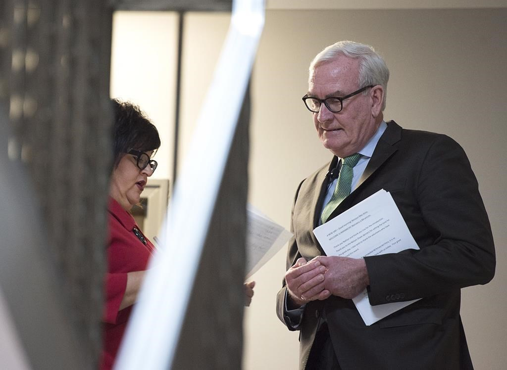 Kevin Vickers, the former House of Commons sergeant-at-arms, is briefed by Lisa Harris, left, MLA for Miramichi Bay-Neguac, before he announces his intention to run for the leadership of the New Brunswick Liberals, in Miramichi, N.B. on Friday, March 15, 2019.