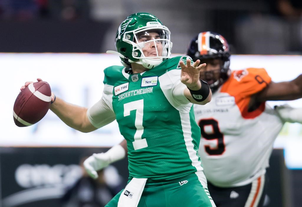 Saskatchewan Roughriders quarterback Cody Fajardo passes against the B.C. Lions during the first half of a CFL football game in Vancouver on October 18, 2019. Saskatchewan Roughriders quarterback Craig Dickenson said he's confident Cody Fajardo will be ready to go for Sunday's CFL West final after seeing his star quarterback in a full practice Thursday.