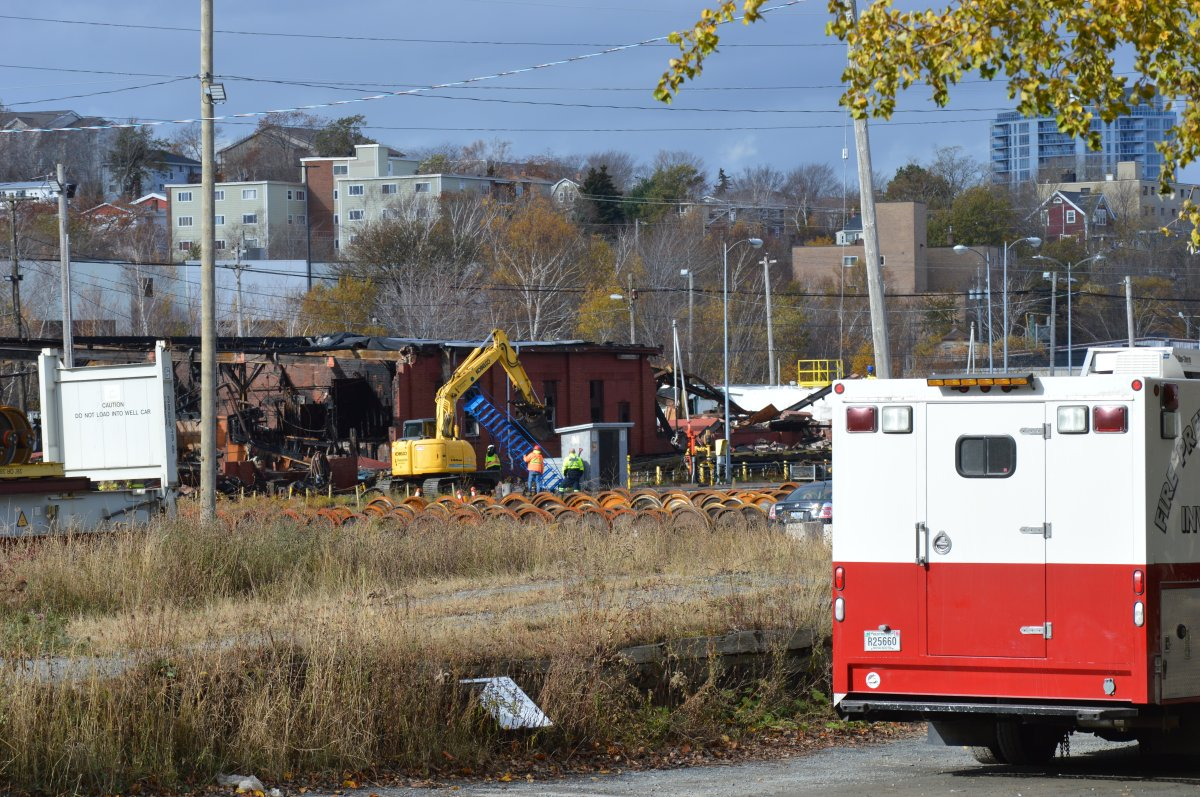 Halifax Regional Fire and Emergency investigators sweep through the scene of a fire at a CN rail yard at Chisholm Avenue on Nov. 10, 2019.