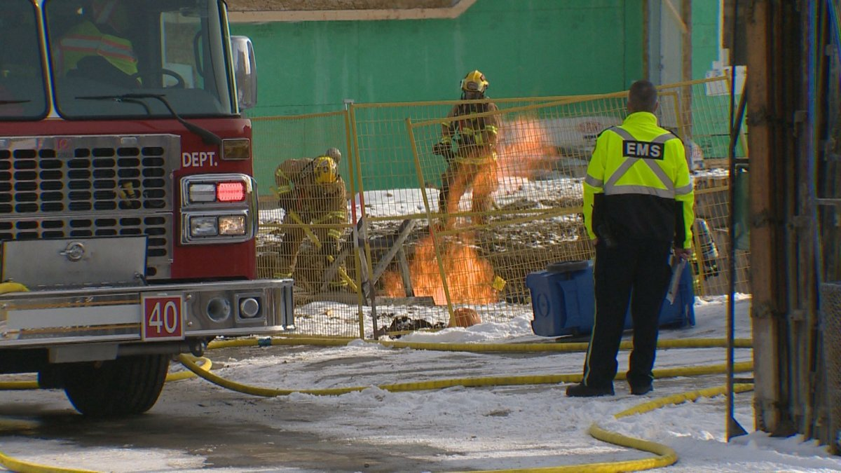 Calgary firefighters on the scene of a gas line fire in Calgary, .