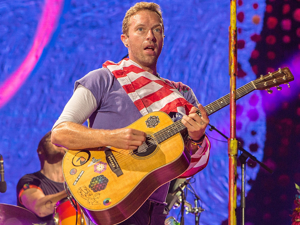 Chris Martin of Coldplay performs on stage at SDCCU Stadium on Oct. 8, 2017 in San Diego, Calif.