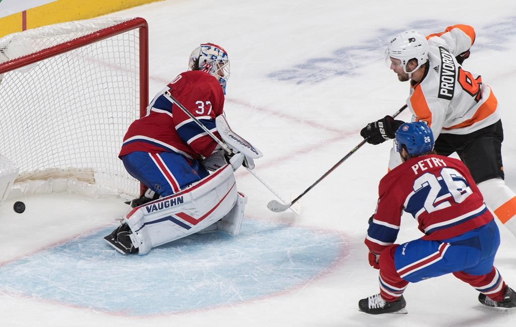 Philadelphia Flyers' Ivan Provorov (9) scores against Montreal Canadiens goaltender Keith Kinkaid as Canadiens' Jeff Petry defends during overtime NHL hockey action in Montreal, Saturday, Nov. 30, 2019.