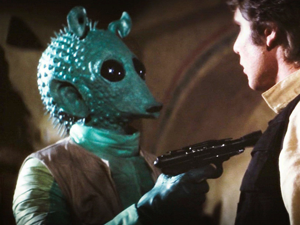 (L-R) Greedo and Han Solo (Harrison Ford) in 'Star Wars: Episode IV — A New Hope,' 1977.