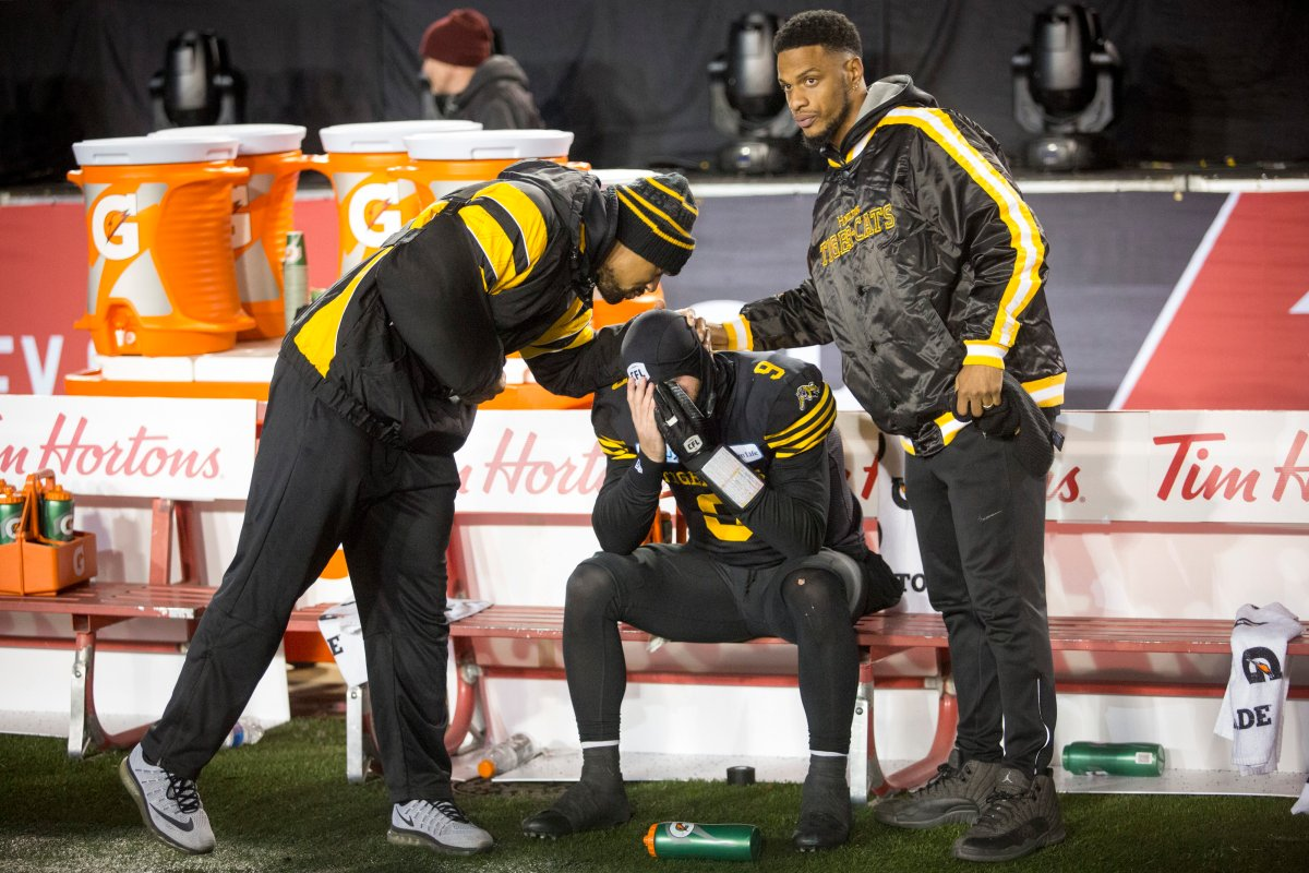 Hamilton Tiger-Cats quarterback Dane Evans, centre, is comforted following the team's loss to the Winnipeg Blue Bombers in the CFL Grey Cup in Calgary, Sunday, Nov. 24, 2019.