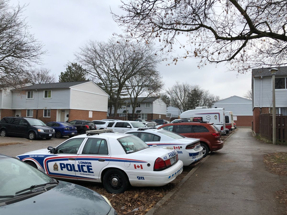Police cruisers fill a complex on Millbank Drive, south of Southdale Road East, following report of a shooting Sunday night.