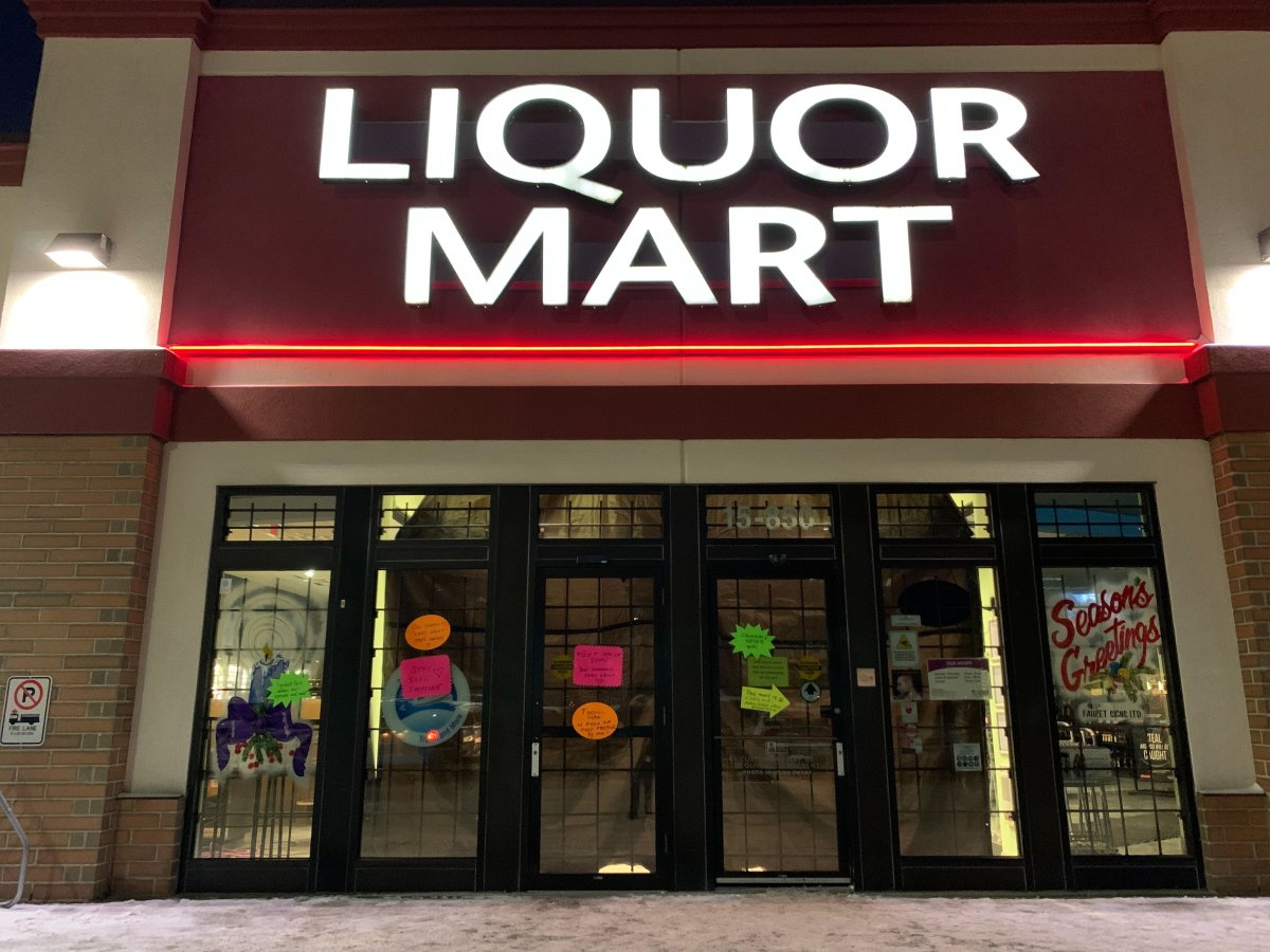 Signs posted on the doors and windows of the Tyndall Park Liquor Mart.