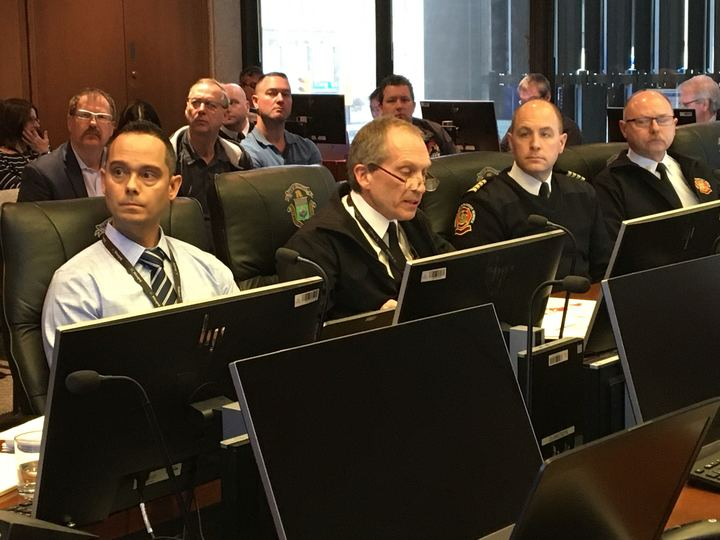 Winnipeg fire chief John Lane (centre) speaks at a city council committee meeting Saturday.