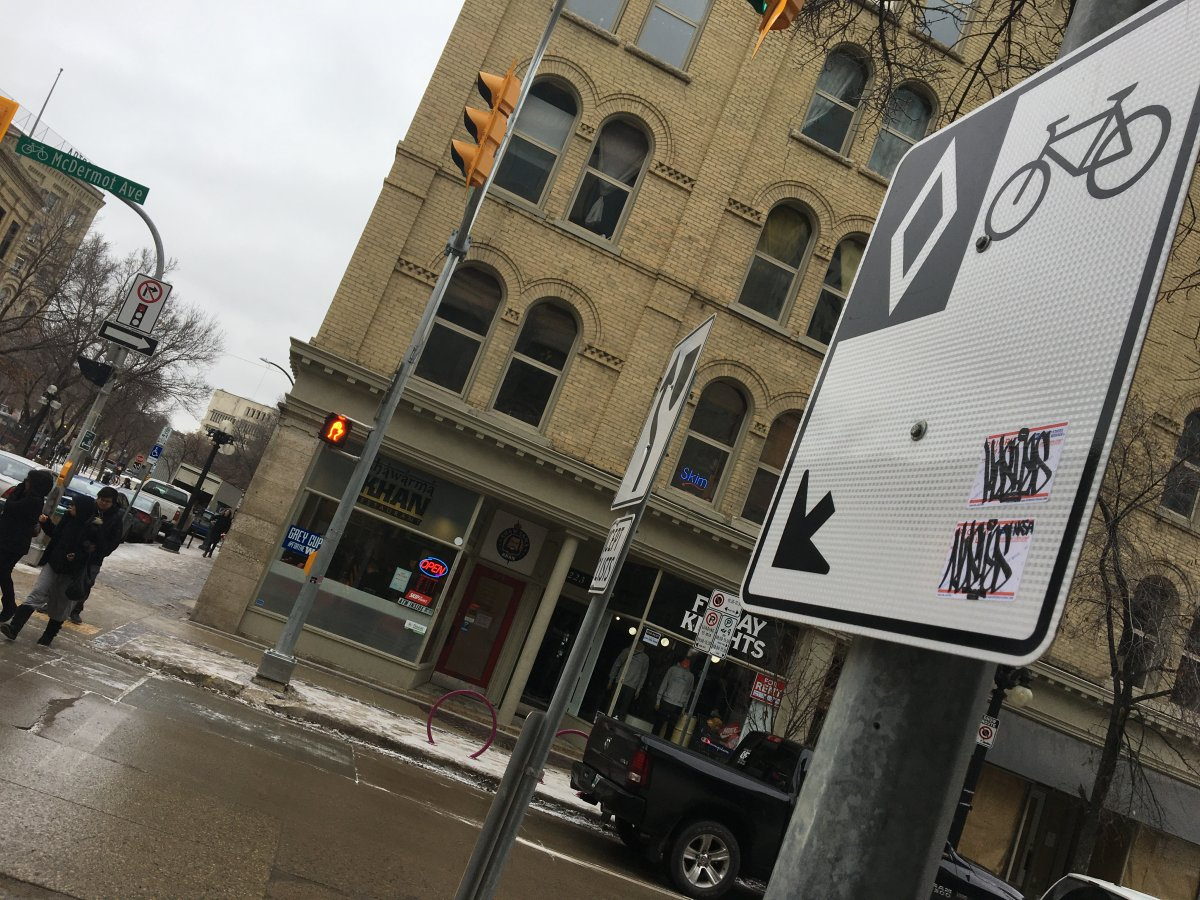 Business owners in the Exchange District, including Shawarma Khan owner Obby Khan, are calling for parking rates to be cut.