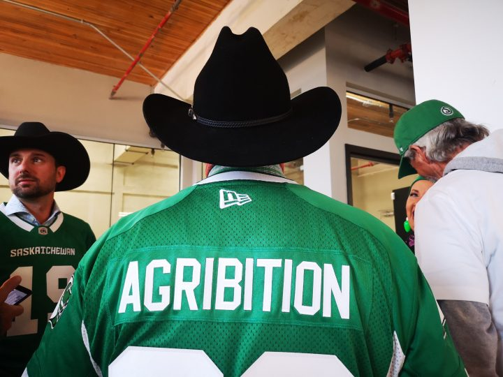Canadian Western Agribition President Chris Lees is seen wearing a custom Saskatchewan Roughriders jersey following a partnership announcement by the two organizations.