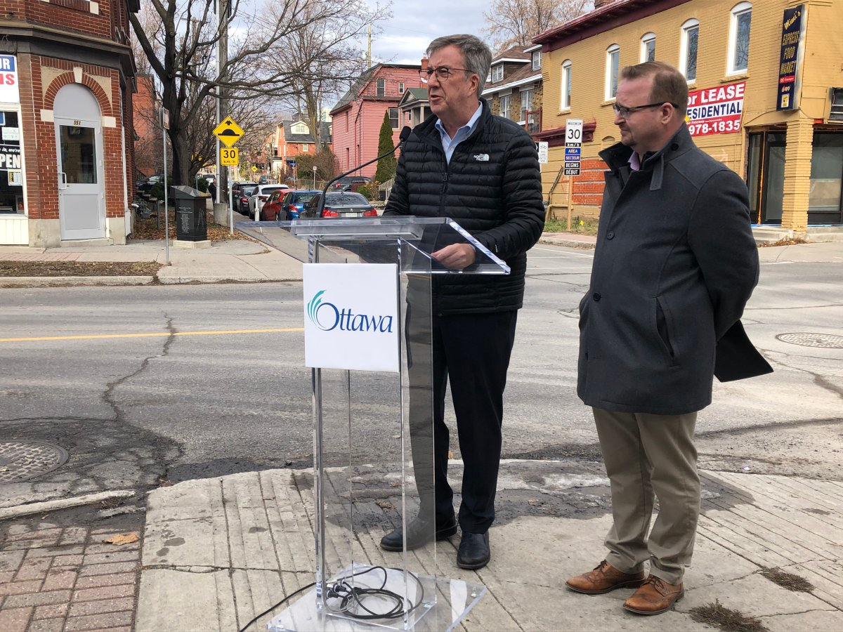 Ottawa Mayor Jim Watson and transportation committee chair Coun. Stephen Blais outline the city's new five-year action plan on road safety at a downtown intersection on Monday, Nov. 25, 2019.