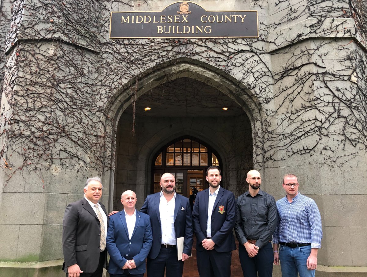 From left to right: York Developments chairman Mike Meddaoui, Middlesex County CAO Bill Rayburn, York Developments president Ali Soufan, Middlesex County warden Kurtis Smith, Nathan Campbell of EllisDon and Randy Reymer of EllisDon stand in front of the Middlesex County building on 399 Ridout St.