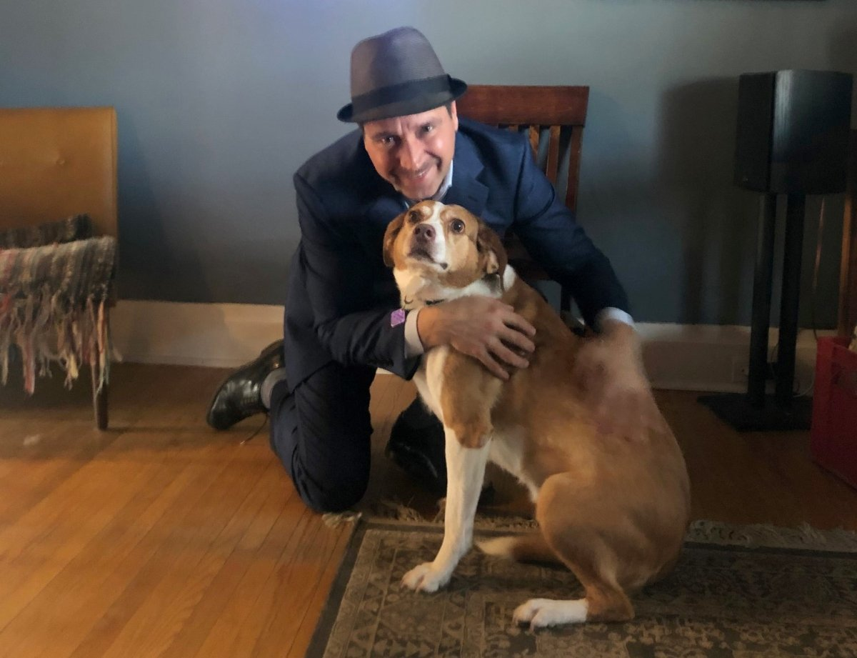 Joe Grant of LLF law firm and his dog, Molly who he adopted from the Peterborough Humane Society five years ago. The law firm is pledging $25,000 for the society's animal care centre campaign.