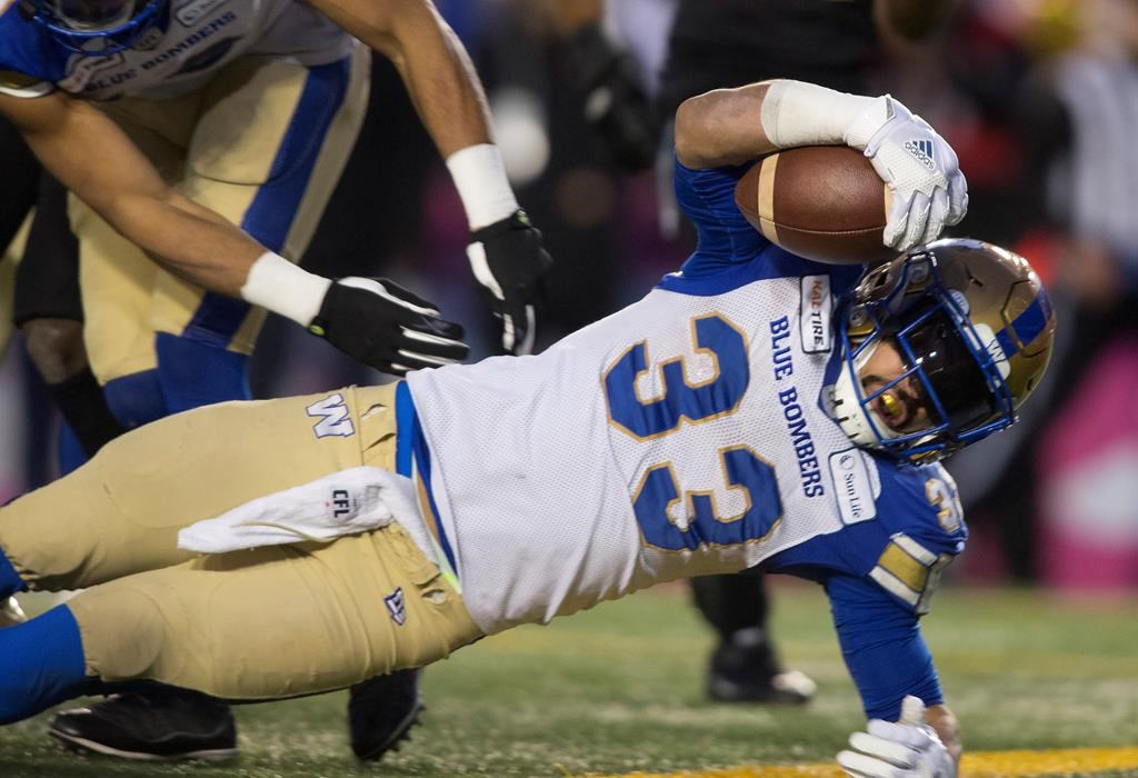 Winnipeg Blue Bombers' Andrew Harris scores a touchdown against the Hamilton Tiger Cats during first half football action in the 107th Grey Cup in Calgary, Alta., Sunday, November 24, 2019.