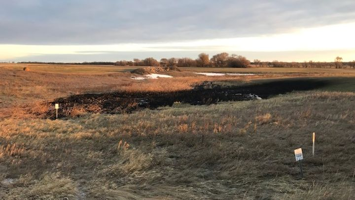 Damage from a pipeline leak in a field near Edinburg, N.D. is seen in this undated handout photo. Prices for Western Canadian Select oil continued to soften on Monday as TC Energy Corp. reported recovering about half the crude that leaked from its Keystone pipeline in North Dakota last week.