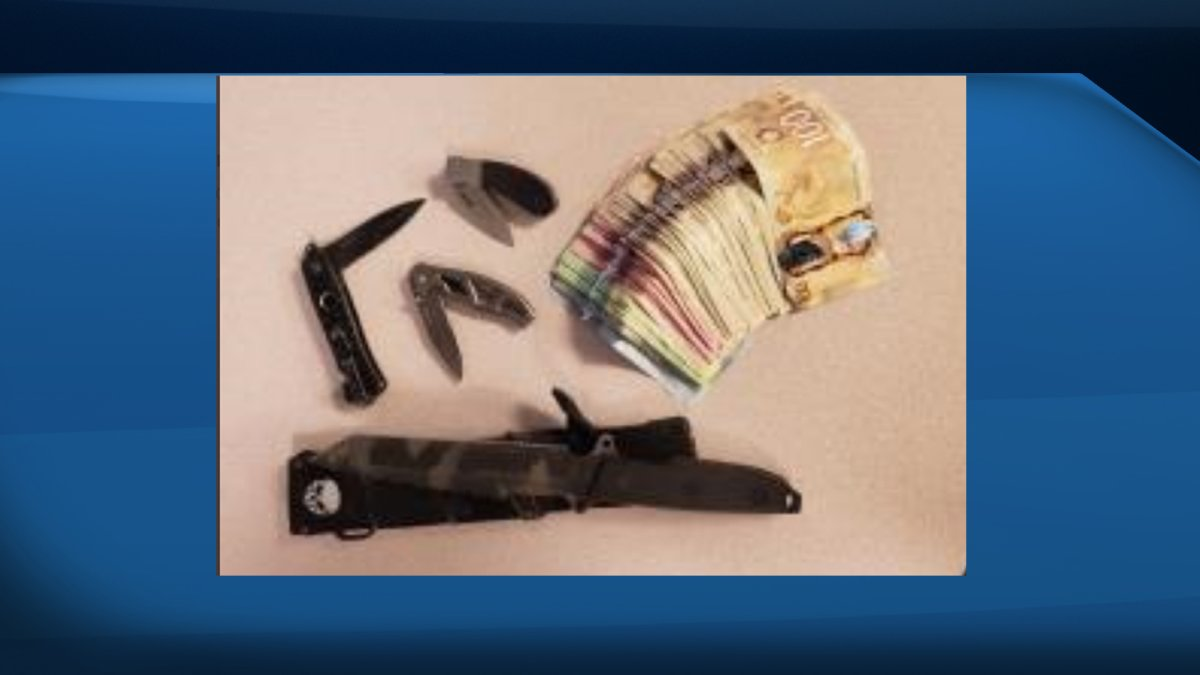 Waterloo Regional Police say they seized several knives as well as cash from a suspected stolen vehicle on Saturday.
