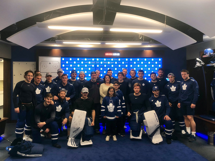 Kade Foster and his family are pictured with the Leafs on Saturday.