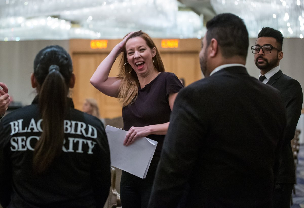 Writer Meghan Murphy laughs while flanked by security before speaking during a panel discussion on gender identity in Vancouver, Saturday, Nov. 2, 2019.