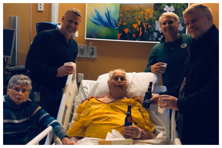 Norbert Schemm, centre, shares a beer with his wife Joanne and sons Tom, Bob and John in Appleton, Wisc., on Nov. 20, 2019.