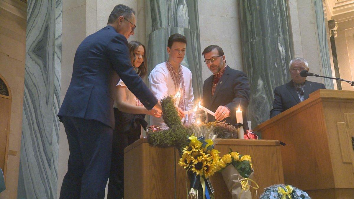 Greg Ottenbreit, the minister responsible for Saskatchewan-Ukrainian relations, lights a candle at the Saskatchewan legislature to commemorate Holodomor.