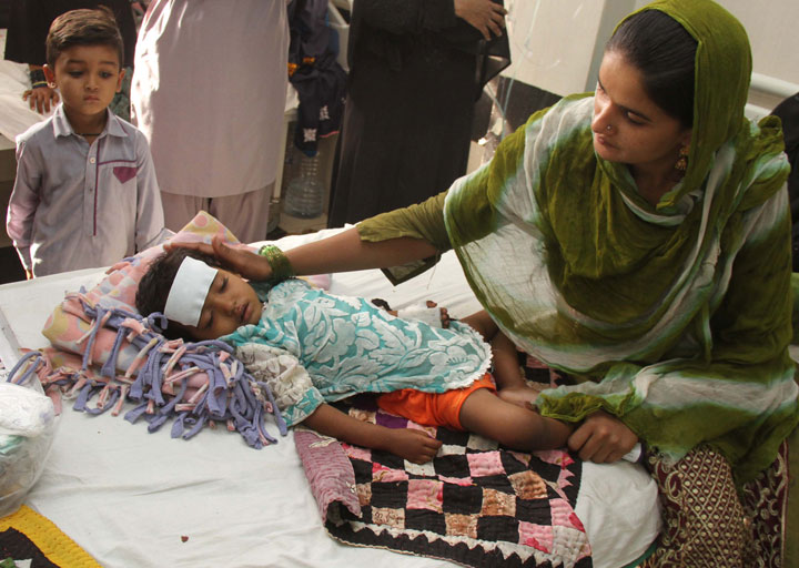 A girl suspected of suffering from a drug-resistant typhoid receives medical treatment at a hospital in Hyderabad, Pakistan, 23 February 2018. Dozens of children have died in Hyderabad as a result of what has been termed the world's first outbreak of drug-resistant typhoid. According to reports, the typhoid strain causing the outbreak acquired an additional piece of DNA to become resistant to multiple antibiotics, including a third-generation antibiotic.
