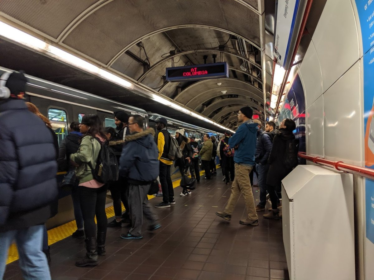 Passengers embark a SkyTrain in Vancouver.