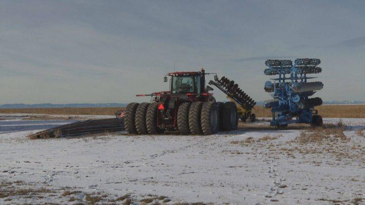 Farming equipment sits in an Alberta farmer's snowy field. Nov. 28, 2019.