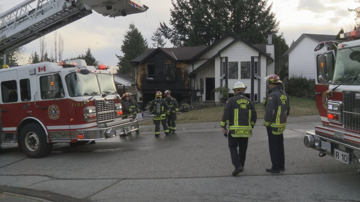 Crews mop up after a house fire in Surrey on Wednesday morning.