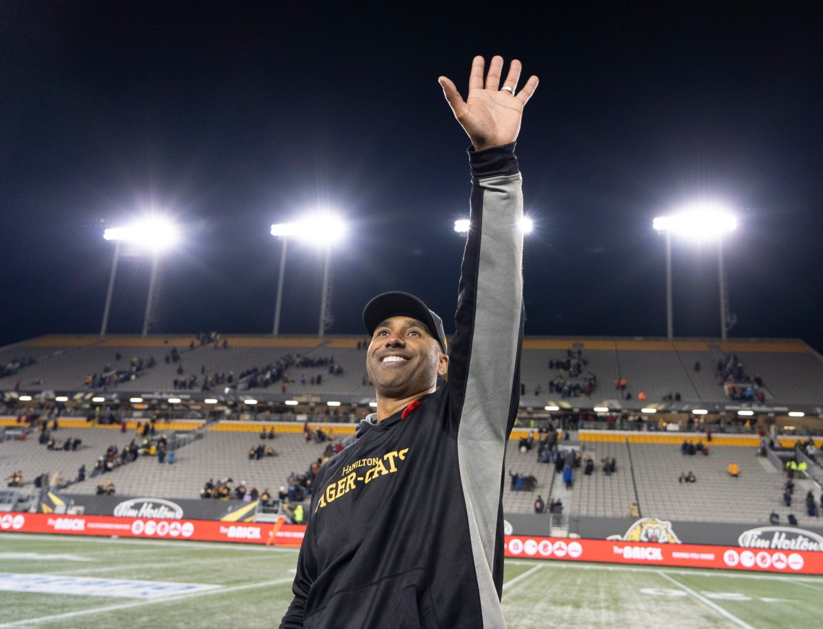 Hamilton Tiger-Cats head coach Orlondo Steinauer waves to people in the crowd following CFL football action against the Toronto Argonauts, in Hamilton, Ont., Saturday, Nov. 2, 2019.
