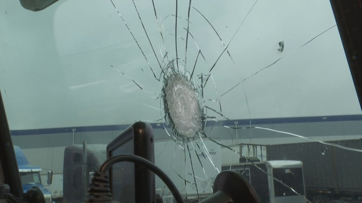 The damage to the windshield of a truck caused by a flying object, which the driver says was thrown by two teenagers from an overpass in Abbotsford on Nov. 15, 2019.