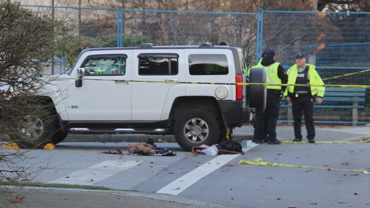 Police at the scene of a fatal collision in Burnaby on Wednesday.