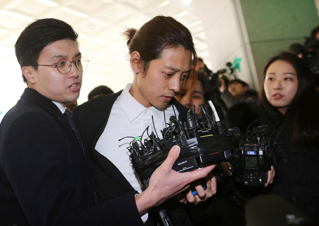 K-pop singer Jung Joon-young, centre, arrives at the Seoul Metropolitan Police Agency in Seoul, South Korea.