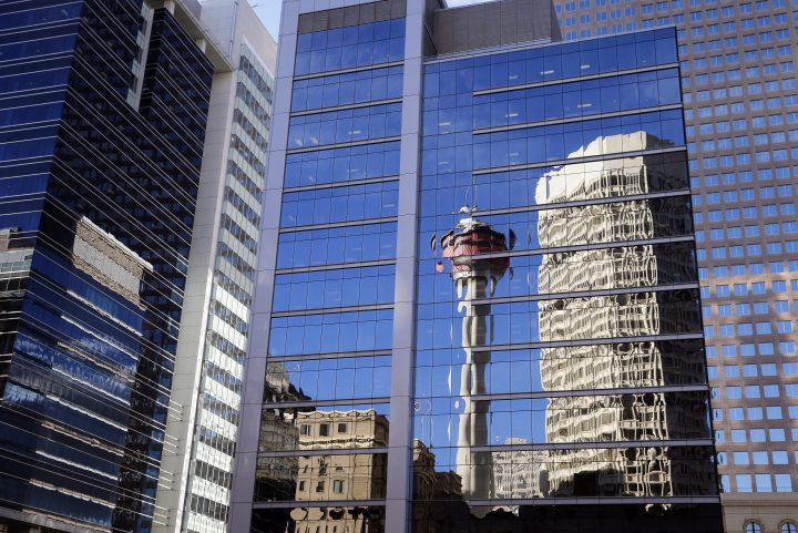 The Calgary Tower reflected on office building windows in downtown Calgary, Alberta on Dec. 22, 2014.
