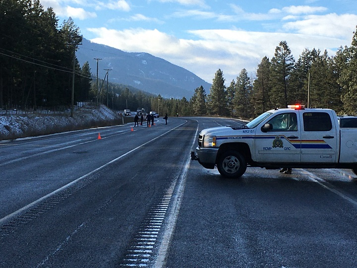 A police vehicle can be seen blocking traffic along Highway 97 near Westwold on Dec. 3, 2019.