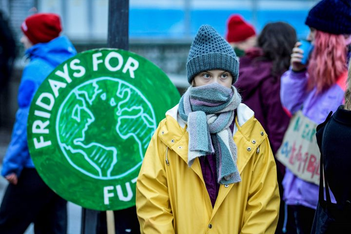 """FILE -- Swedish environmental activist Greta Thunberg attends a climate strike of the """"Fridays For Future"""" movement outside the Swedish parliament Riksdagen in Stockholm, Dec. 20, 2019."""
