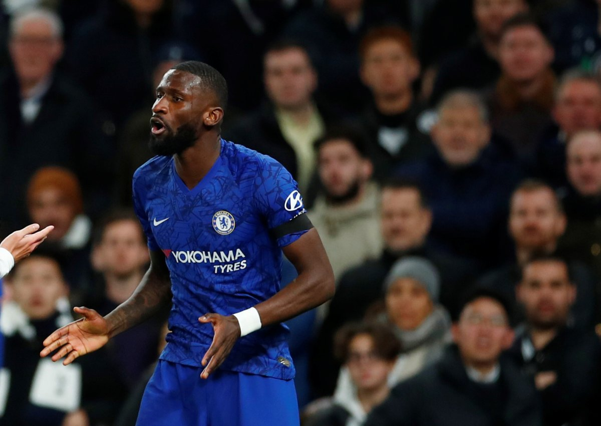 Chelsea's Antonio Rudiger reacts as Tottenham fans look on.