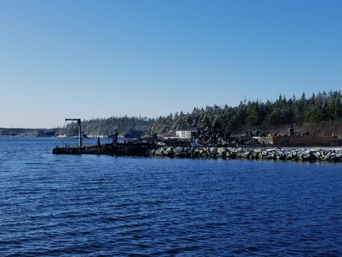 Rubble is all that's left of Abriel Fisheries in Tangier, N.S. after a devastating fire on Dec. 18, 2019. It's seen here the following afternoon, as investigators search for clues as to the cause of the blaze.