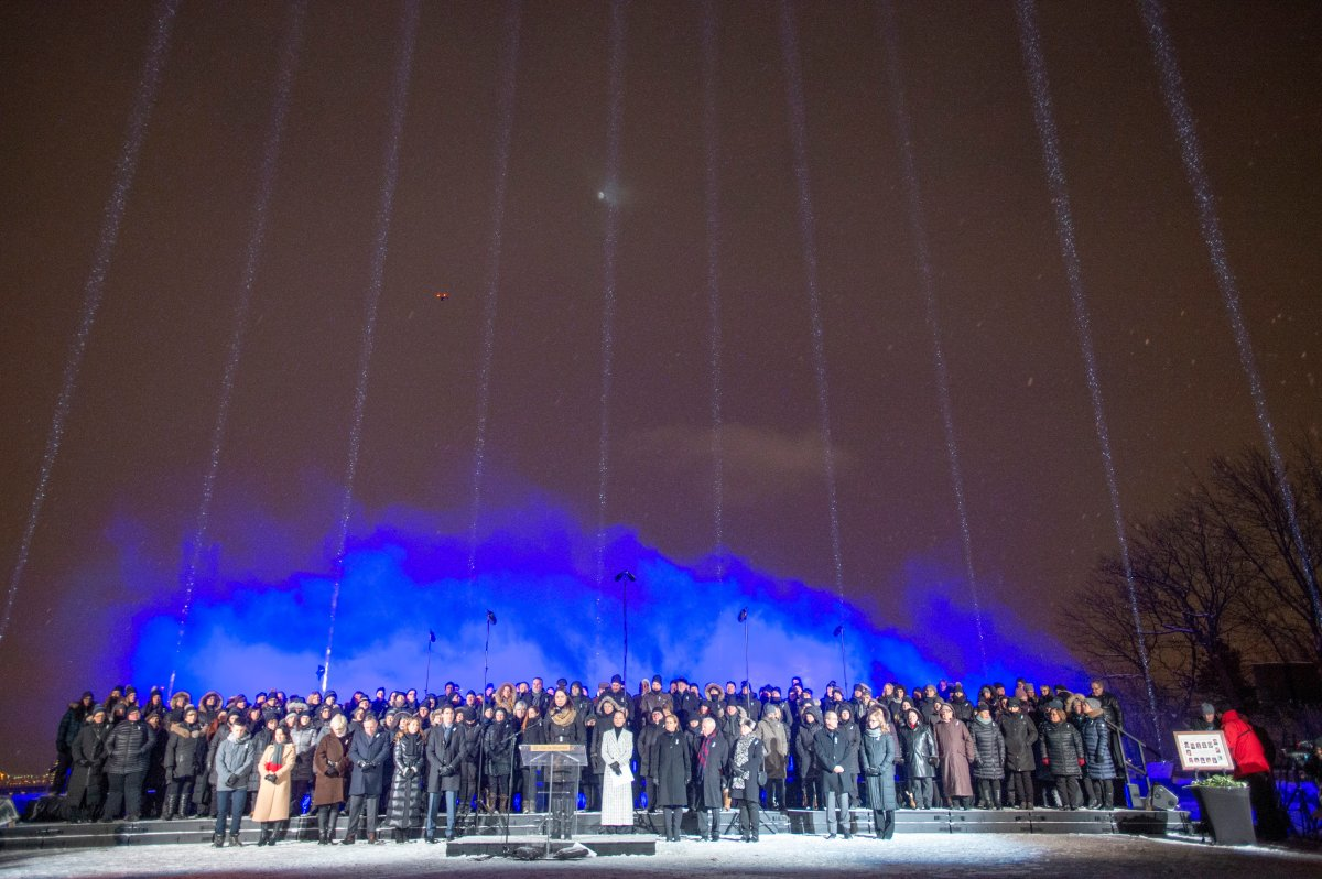 Fourteeen beams of light point skyward during ceremonies to mark the 30th anniversary of the 1989 École Polytechnique attack where a lone gunman killed 14 female students, Friday, December 6, 2019 in Montreal.