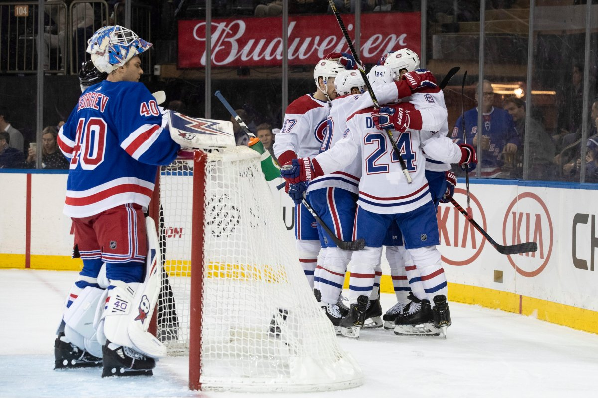 New York Rangers goaltender Alexandar Georgiev (40) reacts as the Montreal Canadiens celebrate a goal by right wing Brendan Gallagher (11) during the first period of an NHL hockey game Friday, Dec. 6, 2019, at Madison Square Garden in New York.