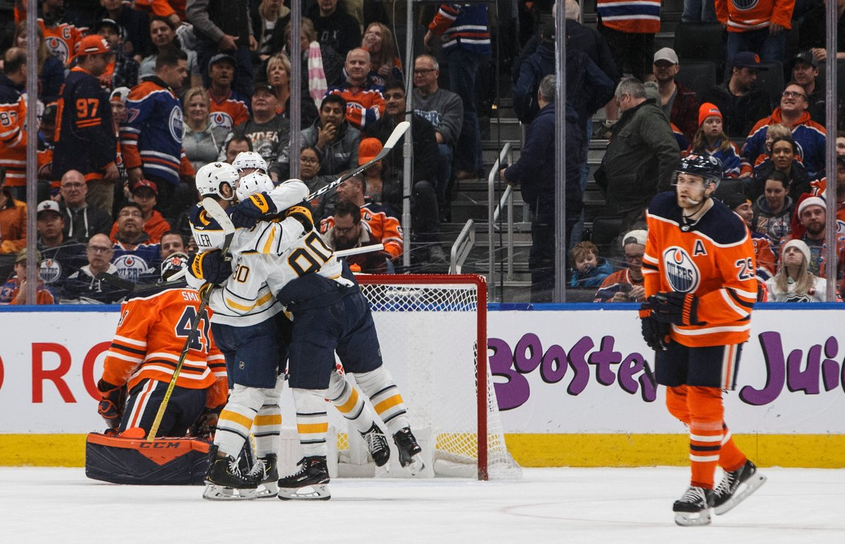 Buffalo Sabres players celebrate the overtime goal against the Edmonton Oilers during NHL action in Edmonton, Alta., on Sunday December 8, 2019. THE CANADIAN PRESS/Jason Franson.