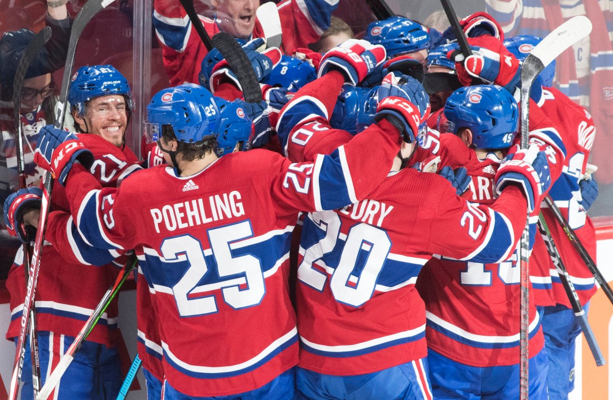 Players from the Montreal Canadiens celebrate after defeating the Ottawa Senators in an NHL hockey game in Montreal, Wednesday, December 11, 2019.