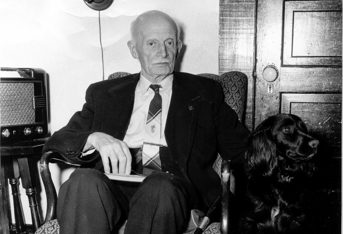 Former federal and provincial politician Alan Webster Neill sits with his dog in a photo from 1955 at the age of 87. The Alberni School District in B.C. is preparing a public consultation for the renaming of A.W. Neill Elementary School, over Neill's support of anti-Chinese laws in the legislature and his approval of Indigenous residential schools.