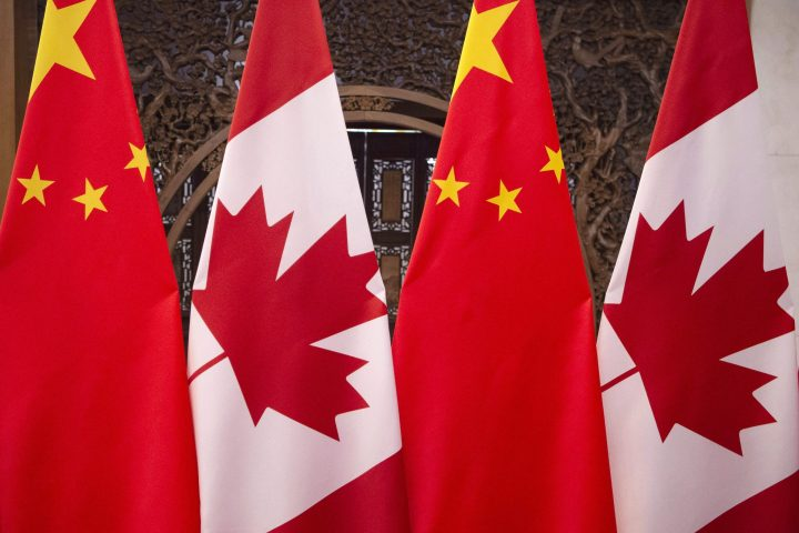 This Dec. 5, 2017, photo shows flags of Canada and China prior to a meeting of Canadian Prime Minister Justin Trudeau and Chinese President Xi Jinping at the Diaoyutai State Guesthouse in Beijing.