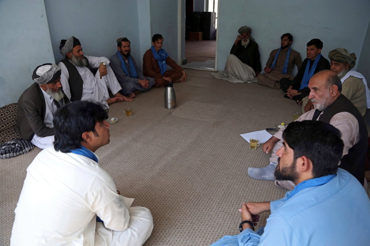 In this Aug. 29, 2019 filephoto, members of the peace movement chat after an interview in Kabul, Afghanistan.