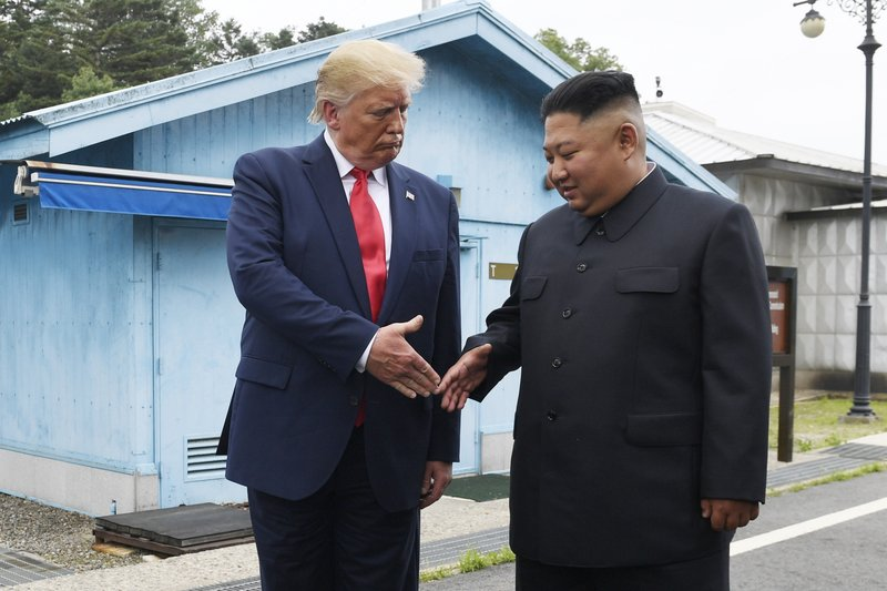 """FILE - In this June 30, 2019, file photo, U.S. President Donald Trump meets with North Korean leader Kim Jong Un at the border village of Panmunjom in the Demilitarized Zone, South Korea. North Korea has again insulted President Donald Trump, calling him a """"thoughtless and sneaky old man"""" after he tweeted that North Korean leader Kim Jong Un wouldn't want to abandon a special relationship between the two leaders and affect the American presidential election by resuming hostile acts."""