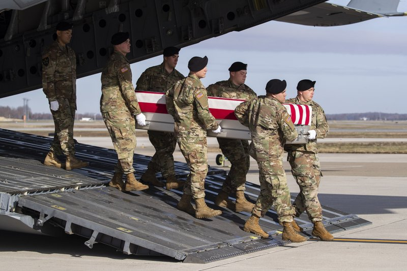 FILE - In this Dec. 25, 2019, file photo, an Army carry team moves a transfer case containing the remains of U.S. Army Sgt. 1st Class Michael Goble, at Dover Air Force Base, Del.. Goble, a U.S. Special Forces soldier who died in Afghanistan this week, was seizing a Taliban weapons cache when he was killed, the U.S. military said Friday.
