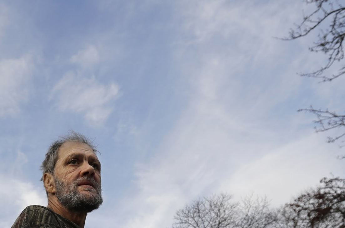 In this Friday, Dec. 20, 2019 photo, Bobby Goldberg looks to the road in front of his home in suburban Chicago. Goldberg has filed a lawsuit claiming he was abused more than 1,000 times in multiple states and countries by the late Donald McGuire, a prominent American Jesuit priest who had close ties to Mother Teresa.