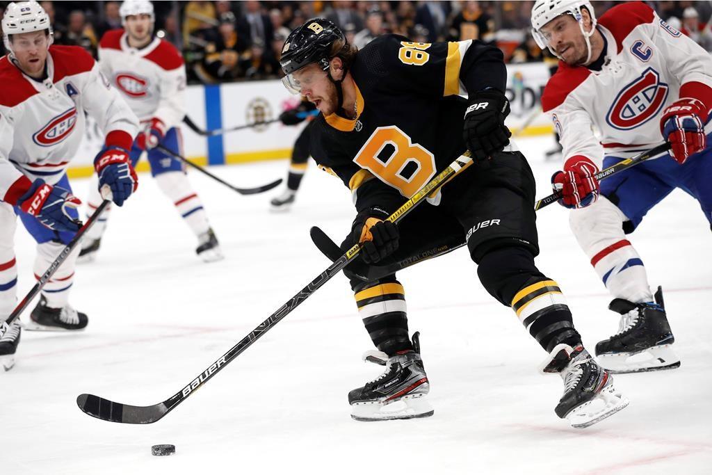 Boston Bruins' David Pastrnak goes around Montreal Canadiens defenceman Shea Weber on Sunday, Dec. 1, 2019, in Boston.